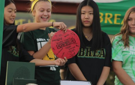Irene Kim, Grace Johnson, Allison Fong, Savannah Schlottach reveal the time capsule's memorabilia. The time capsule contained several items that represented BOHS's school spirit and achievements.