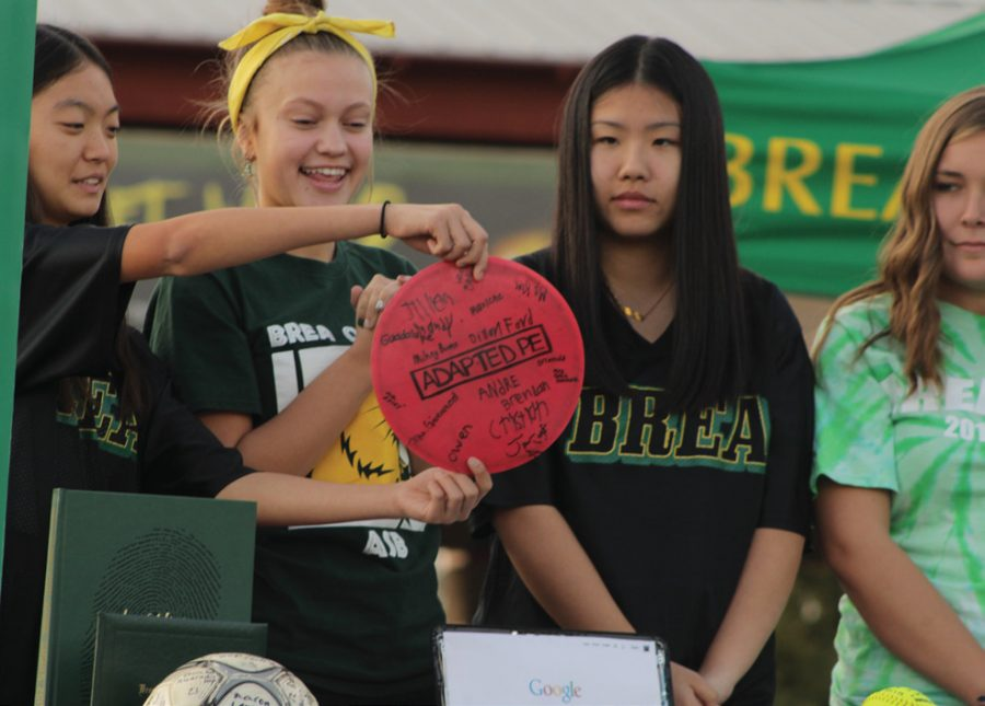 THE BIG REVEAL: Irene Kim, Grace Johnson, Allison Fong, Savannah Schlottach reveal the time capsule's memorabilia. The time capsule contained several items that represented BOHS's school spirit and achievements.