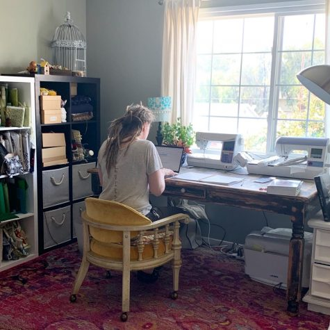 Summer Teal, English teacher, refines a lesson from her home. Teal is one of many teachers at BOHS who juggles distance teaching, and the distance learning of their own children.