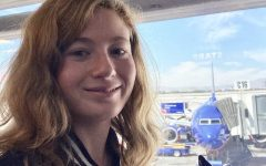 FLIGHT FANATIC: Marissa Forte ('20) holds a replica Southwest aircraft in the Southwest terminal at OC's John Wayne airport. Forte indulges her passion for flight by watching and photographing aircraft taking off and landing at Southern California airports.