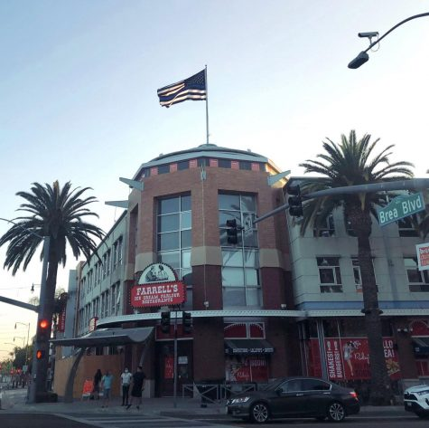 A Thin Blue Line flag towers above Downtown Brea. The flag, purchased by Brea resident and developer Dwight Manley (