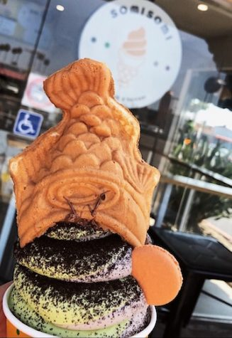 Ah-boong, a multilayered treat consisting of fish-shaped pastry stuffed with filling and topped with soft serve. Taiyakis are fish-shaped snacks best described as a blend of a waffle and a cake filled with azuki sweet red bean paste.