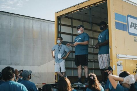 Doug Green, chief visionary officer of Feed Brea, addresses Pop-Up Pantry volunteers before the start of the event on Oct. 3.