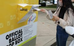 A Brea resident deposits their early voting ballot into an official ballot drop box in Brea on Oct. 25. On the ballot is Proposition 18 which, if passed, will allow 17-year olds to vote in election years.