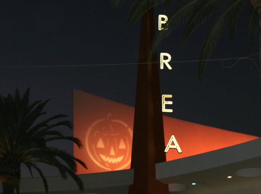 As Brea is getting ready for Halloween, a jack-o-lantern is projected on top of Sky Lounge in Downtown Brea. Although Brea has scaled back its city events, Halloween decorations abound throughout the city.