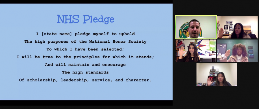 Dr. Joshua Porter, principal, and executive members of National Honor Society, say the NHS pledge to conclude the Nov. 11 induction ceremony. Due to COVID-19, the event was held virtually to introduce new NHS members and the executive board.