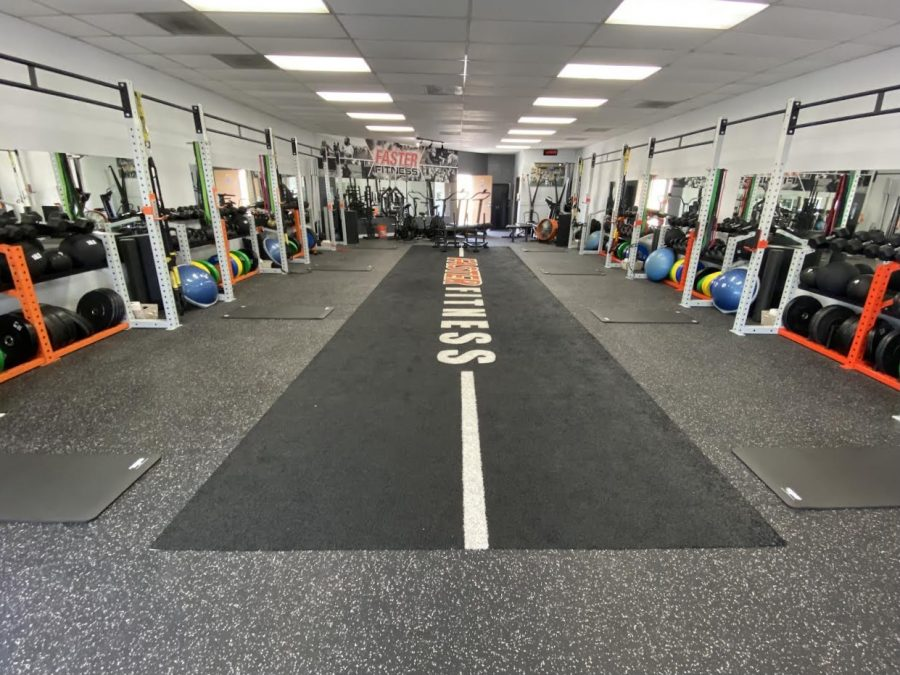 The inside of Faster Fitness includes different types of equipment along the sides in order to allow people to walk around freely.