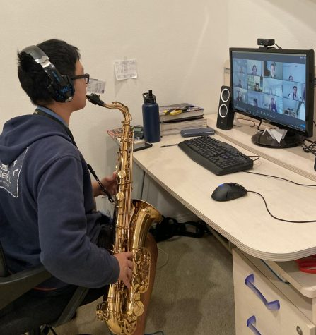 David Lim, sophomore, plays his saxophone during a Dec. 3 marching band practice, held on Zoom. The pandemic has forced Performing Arts programs, like band, to conduct practices and shows online.