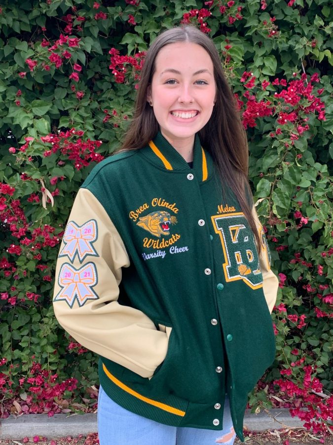 Letterman jackets can be purchased by Varisty athletes at BOHS, and each chenille patch is customized to the athletes achievements. Melea Altermatt, Varsity cheerleader, poses in her letterman jacket.