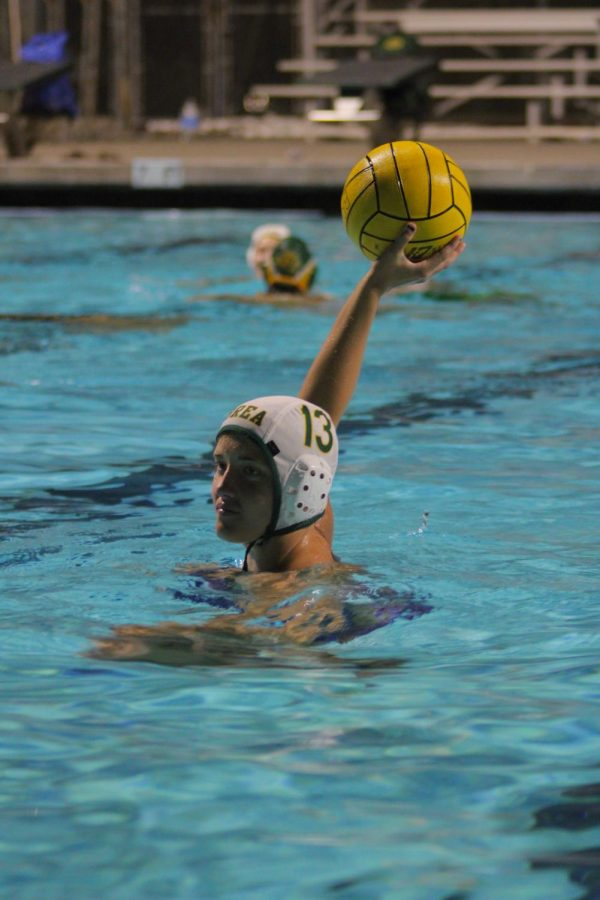 Hannah Adoian, sophomore, prepares to shoot a five meter penalty shot during girls' water polo practice on Feb 25. The Wildcats' first game is against El Modena High School on Monday, March 15.