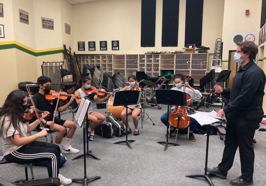 """Kenneth Taber, band director, conducts the Chamber Orchestra practicing """"Harry's Wondrous World"""" at the final after school rehearsal on Tuesday. The Pops Concert will be this Friday, 6 p.m. in the quad."""