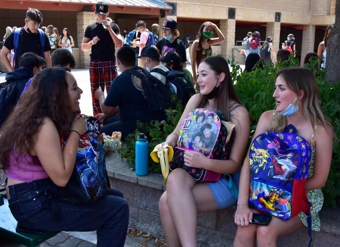 Seniors Sophia Renfro, Emma Koren, and Haylie Kent eat lunch in the Senior Quad on Aug. 18.