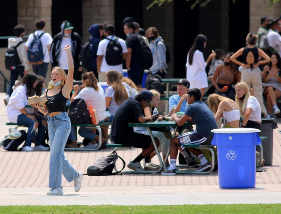 Haylee Long, sophomore, greets students from across the quad. The week of Aug. 16 to Aug. 20 marked the first time in 17 months that the entire student body had access to the quad for lunch.