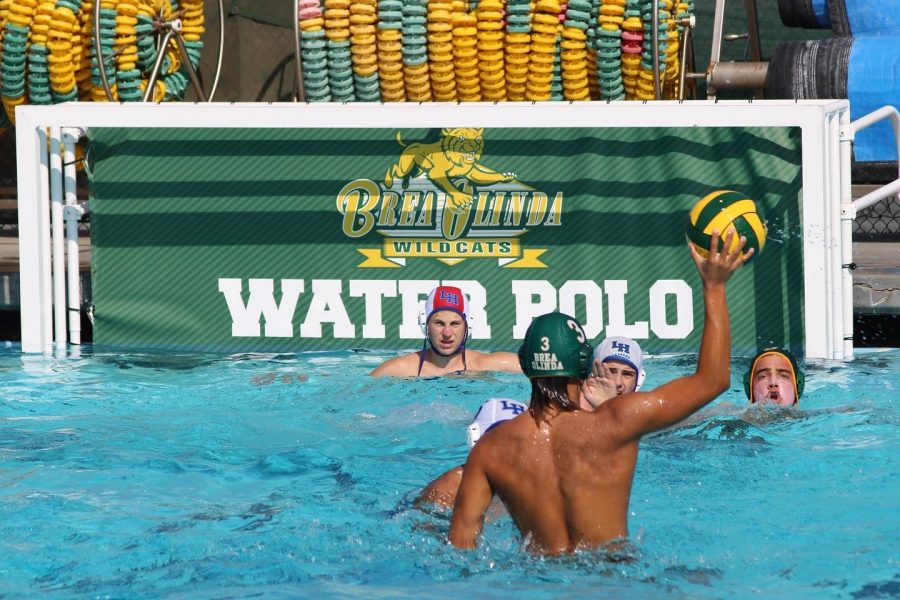 Lee Bullock, senior, attacks the La Habra High School goal at the Aug. 30 varsity contest at the BOHS pool. The Wildcats prevailed, 17-6.