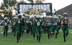Varsity football takes the field before the game against Sunny Hills High School. The Wildcats won the back-and-forth game against the Lancers, 40-37, on senior Andrew Rubios go-ahead touchdown run in the final 25 seconds of the game.