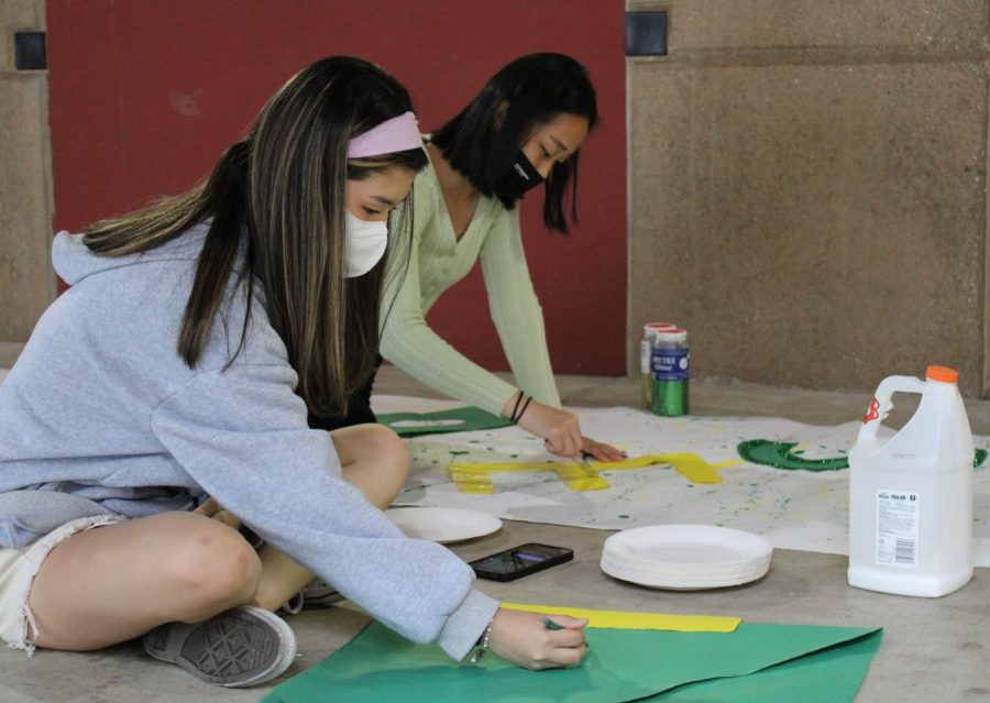 ASBs Kelly Kim and Katie Kim, seniors, make Homecoming posters to promote Fridays Hollywood-themed dance at the Yost Theatre in Santa Ana.